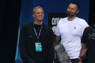 Cody Simpson and Ian Thorpe talk during the 2021 Australian Swimming Championships.