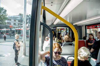Commuters on the Sydney light rail during peak hour on Monday morning.