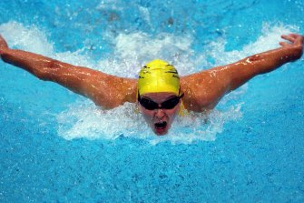 Madam Butterfly: Susie O'Neill with chest high and arms wide in the 200 fly.