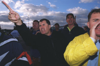 Locked-out unionists haranguing non-union workers as they enter the Patrick terminal at Port Botany.