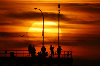The sun rises over Melbourne during a heatwave in 2018.