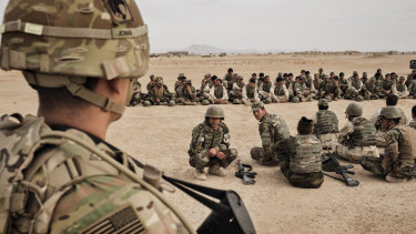 US Army soldiers oversee training of Afghan National Army soldiers at Camp Bastion, Helmand Province, Afghanistan.