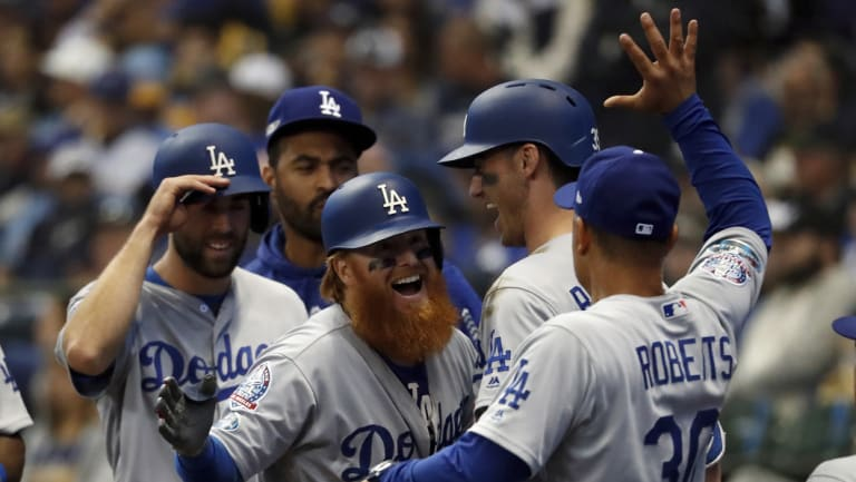 Justin Turner is congratulated by Dodgers manager Dave Roberts.