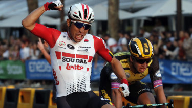 Australia's Caleb Ewan celebrates as he crosses the finish line to win the 21st stage of the Tour de France.