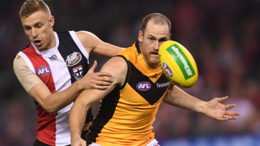 Rough and ready: Back in action for Hawthorn, veteran Jarryd Roughhead takes on Callum Wilke during the round 4 loss to St Kilda at Marvel Stadium.
