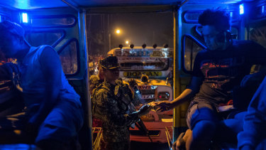 Soldiers halt vehicles for inspection at the entrance to Zamboanga in the southern Philippines in February.