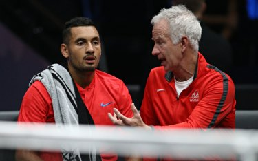 Mentor: McEnroe imparts a few pearls of wisdom to Kyrgios during the Laver Cup.