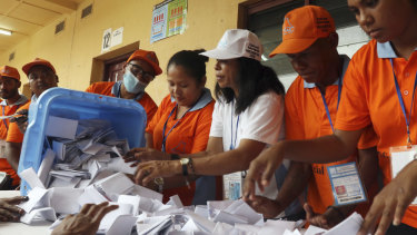 Electoral workers open a ballot box during the vote counting at a polling station following the parliamentary election in Dili, East Timor on May 12.