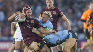 He's back: Kalyn Ponga in action for the Maroons last year . . . this time he's in a more familiar role.