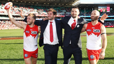 Retiring Swans Kieren Jack, Nick Smith, Heath Grundy and Jarrad McVeigh during a lap of honour after Saturday's match.