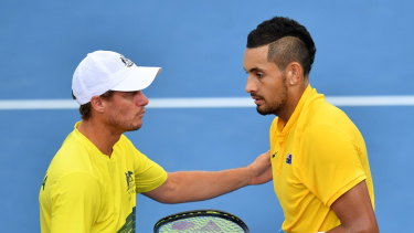 Together again: Lleyton Hewitt (left) and Nick Kyrgios.