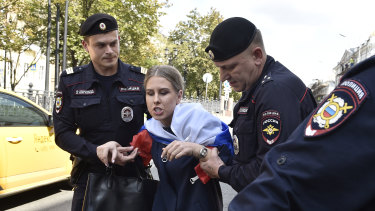 Police officers detain opposition candidate and lawyer at the Foundation for Fighting Corruption Lyubov Sobol prior to an unsanctioned rally in Moscow.