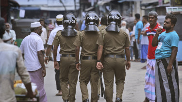 Sri Lankan policeman on patrol in a Muslim neighbourhood in Colombo.