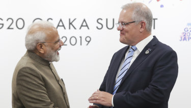 Prime Minister Scott Morrison with the Prime Minister of India, Narendra Modi, during the G20 summit. The pair were seated next to each other at an official dinner.