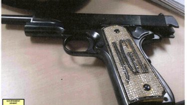 A diamond-encrusted pistol, monogrammed with the initials of  Joaquin 'El Chapo' Guzman Loera.