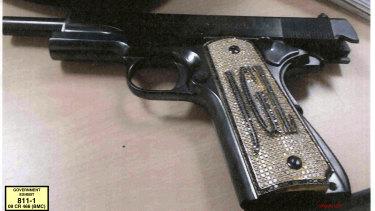 "A diamond-encrusted pistol, monogrammed with the initials of  Joaquin ""El Chapo"" Guzman."