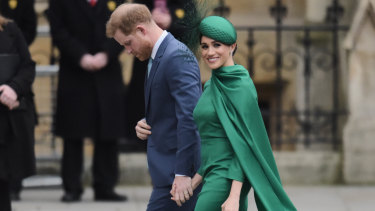 Looking smart: Meghan and Prince Harry.