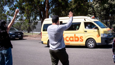 Refugee advocates wave to a van load of refugees leaving a detention centre in Broadmeadows on Wednesday.