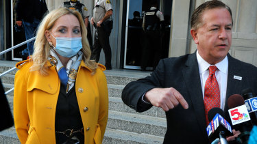 Mark McCloskey addresses the media  alongside his wife Patricia on Tuesday, outside the Carnahan Courthouse in St. Louis.