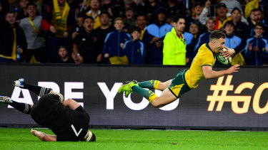 Nic White leaps in the air before scoring in Saturday's Bledisloe Cup opener in Perth.