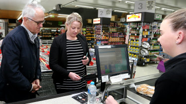 Then prime minister Malcolm Turnbull viewing a demonstration of the cashless cards at a Ceduna supermarket in 2016.