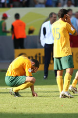 Australian players look devastated after Italy kicks the winning goal off a penalty.