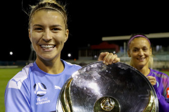 City's Stephanie Catley  with the W-League trophy.