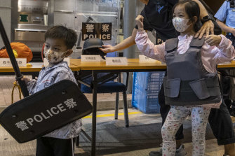 Young visitors at the Hong Kong Police College in Hong Kong during National Security Education Day on Thursday.