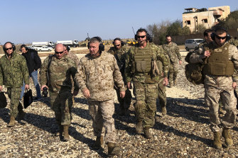 General Frank McKenzie (centre) the top US commander for the Middle East on Saturday, during an unannounced visit to military outposts in Syria.