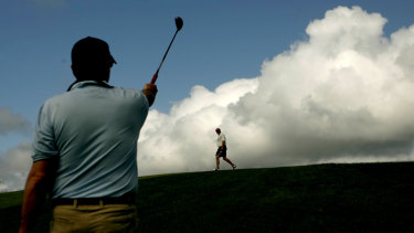 Golfers playing a round at St Michaels Golf Course at Little Bay in the eastern suburbs, which is Crown land.
