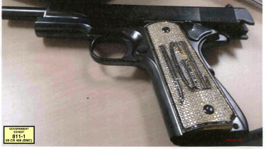 "A diamond-encrusted pistol that a government said belonged to ""El Chapo"", monogrammed with his initials JGL - Joaquin Guzman Loera."