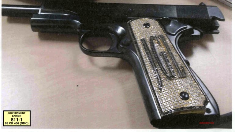 "A diamond-encrusted pistol, monogrammed with the initials of  Joaquin ""El Chapo"" Guzman Loera."