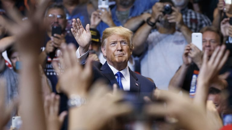 President Donald Trump waves to the cheering crowd as he arrives for a political rally in Wilkes Barre, Pennsylvania.