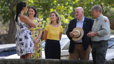 Premier Gladys Berejiklian, second from left, and Environment Minister Gabrielle Upton, centre, at the national parks announcement.