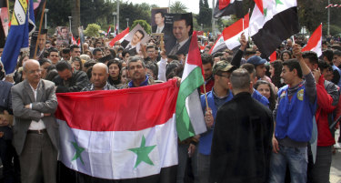 In this photo released by the official government news agency, Syrians in the costal port city of Tartus protest against US President Donald Trump's move to recognise Israeli sovereignty over the occupied Golan Heights.