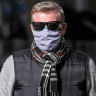 Some shoppers refuse to wear masks as Melbourne adjusts to new must-have attire