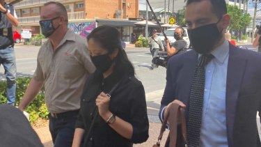 Dr Maria Carmel Pau leaves Southport Magistrates Court with a court chaplain (left) and her lawyer Ali Rana.