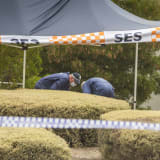 Investigators examine the woman's body found in Bundoora.