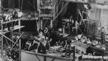 Diggers (1931): Filming the trench scenes of the WWI comedy, produced and directed by F. W. Thring, in the derelict His Majesty's Theatre, Exhibition Street, Melbourne.