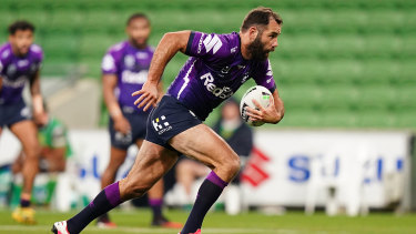 Cameron Smith on the run for the Storm against Canberra at AAMI Park on Saturday night.