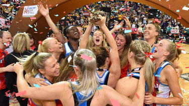 The NSW Swifts celebrate their 2019 grand final win.