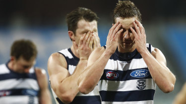 Cats lose their cool: Mitch Duncan and Patrick Dangerfield walk off after the round 3 loss to Carlton at their home ground 'fortress' GMHBA Stadium in Geelong.