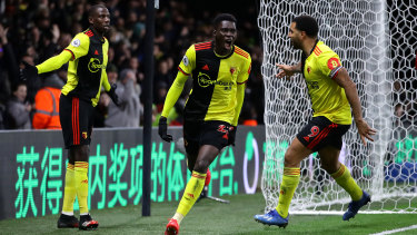 Sarr celebrates the opener at Vicarage Road.