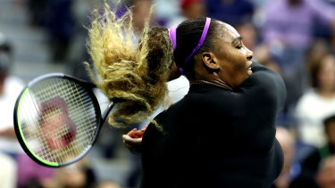 Star attraction: Williams returns with interest in front of a celebrity-laden audience at Flushing Meadow.