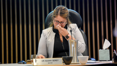 Then Casey mayor Susan Serey wipes away tears at her final council meeting.