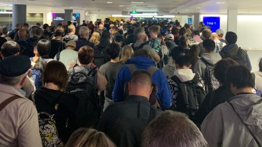 The arrivals queue at Sydney Airport's international terminal as waiting times stretched for 90 minutes after an IT systems outage affected all passengers departing or arriving in Australia.