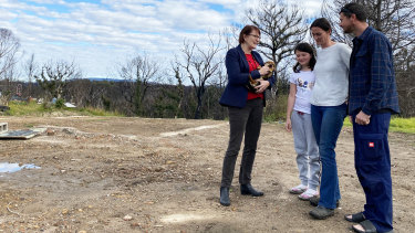 Labor MP for Macquarie Susan Templeman speaks with Keira, Megan and Chris Kezik, who lost their Bilpin home to December's bushfires.