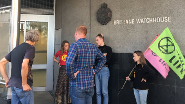 Protesters wait outside the Brisbane watchhouse for fellow activists to be released.