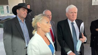 Former Logan councillors Phil Pidgeon, Trevina Schwarz and Russell Lutton, with Ms Schwarz's lawyer Terry O'Gorman outside Brisbane Magistrates Court after their fraud charges were dropped.