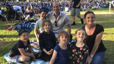 """Friends James Heywood and Lauren Anderson were """"kid-wrangling"""" for the night, in charge of five children under nine. From left to right; Abigail, 6, Christopher, 7, Joshua, 9, and Emily, 5, Caitlin, 6."""